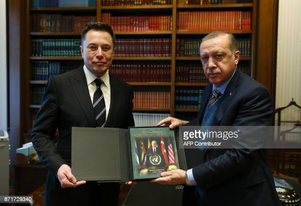 Turkish President Recep Tayyip Erdogan and the founder of US aerospace manufacturer and space transport services company SpaceX Elon Musk pose with a...