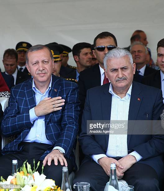 Turkish President Recep Tayyip Erdogan and Turkish Prime Minister Binali Yildirim attend an opening ceremony in Diyarbakir Turkey on May 28 2016