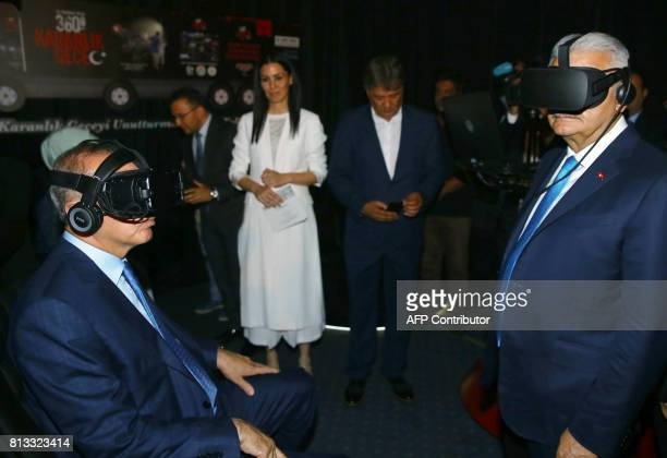 Turkish President Recep Tayyip Erdogan and Turkish Prime Minister Binali Yildirim watch a video with virtual reality glasses prior to a book launch...