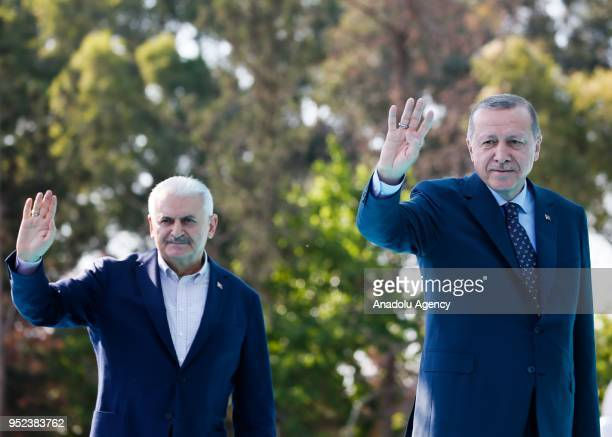 Turkish President Recep Tayyip Erdogan and Turkish Prime Minister Binali Yildirim greet the crowd after attending AK Party's 6th ordinary provincial...