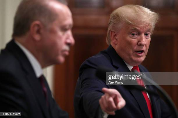 Turkish President Recep Tayyip Erdogan and U.S. President Donald Trump participate in a joint news conference in the East Room of the White House on...