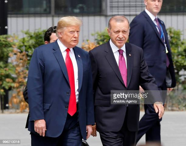 Turkish President Recep Tayyip Erdogan and U.S. President Donald Trump speak to each other during the 2018 NATO Summit at NATO headquarters on July...