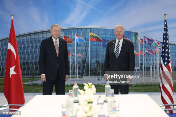 Turkish President Recep Tayyip Erdogan and US President Joe Biden pose for a photo during a meeting at the NATO summit at the North Atlantic Treaty...