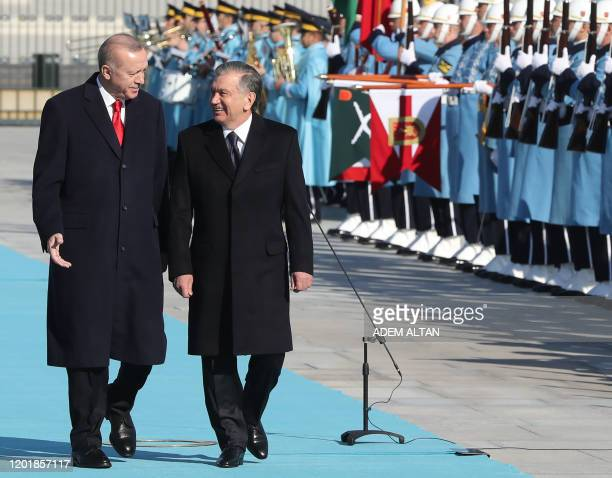 Turkish President Recep Tayyip Erdogan and Uzbekistan President Shavkat Mirziyoyev review the honour guard during a welcoming ceremony at the...