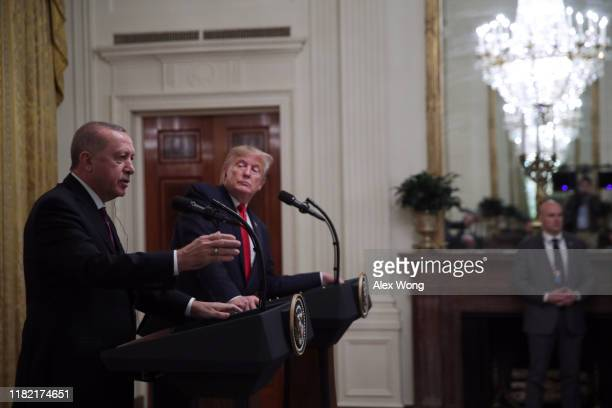 Turkish President Recep Tayyip Erdogan answers a question during a press conference with U.S. President Donald Trump in the East Room of the White...