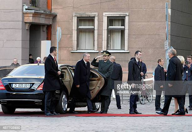 Turkish President Recep Tayyip Erdogan arrives at House of Blackheads to meet with Latvia's President Andris Berzins in Riga Latvia on October 23 2014
