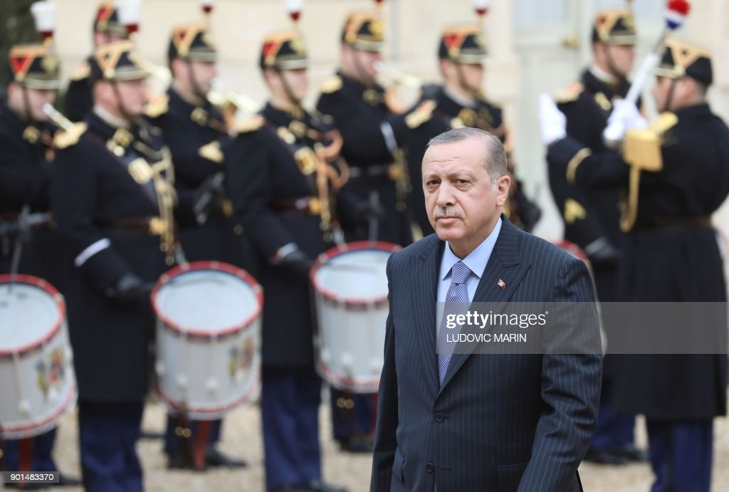 Turkish President Recep Tayyip Erdogan arrives at the Elysee palace in Paris for a meeting with his French counterpart on January 5, 2018 . Erdogan will attempt to reset relations with Europe at talks with France's Emmanuel Macron in Paris on January 5 that are likely to be overshadowed by human rights concerns. /