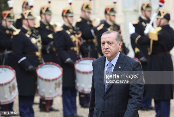 Turkish President Recep Tayyip Erdogan arrives at the Elysee palace in Paris for a meeting with his French counterpart on January 5 2018 Erdogan will...