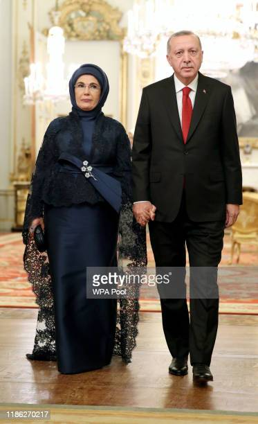 Turkish President Recep Tayyip Erdogan arrives with his wife Emine at a reception for NATO leaders hosted by Queen Elizabeth II at Buckingham Palace...