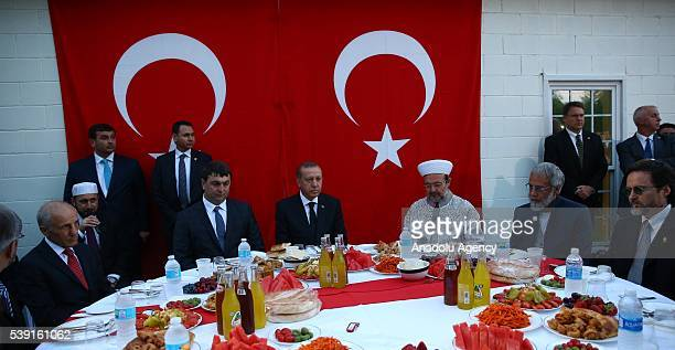 Turkish President Recep Tayyip Erdogan attends an iftar meal to break the Ramadan fast with Ahiska Turks who live in Louisville Kentucky on June 9...