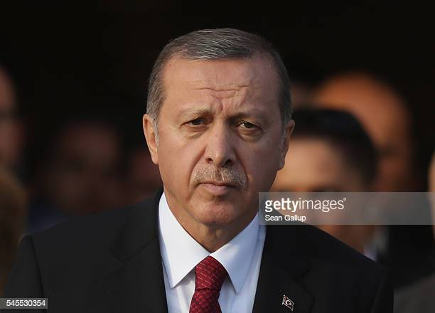 Turkish President Recep Tayyip Erdogan attends the Warsaw NATO Summit on July 8 2016 in Warsaw Poland NATO member heads of state foreign ministers...