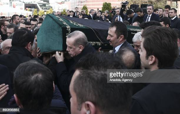Turkish President Recep Tayyip Erdogan carries the coffin of Turkish businessman President of the Executive Board of Istanbul Chamber of Commerce and...