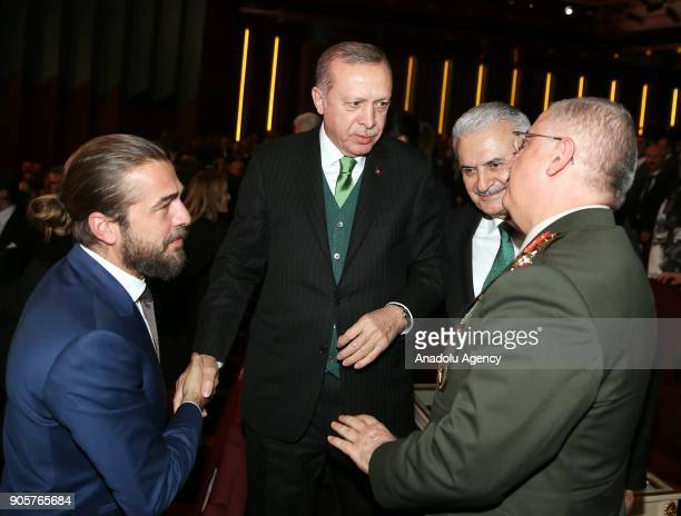 Turkish President Recep Tayyip Erdogan chats with Commander of the Turkish Land Forces Yasar Guler while he greets the Turkish actor Engin Altan...