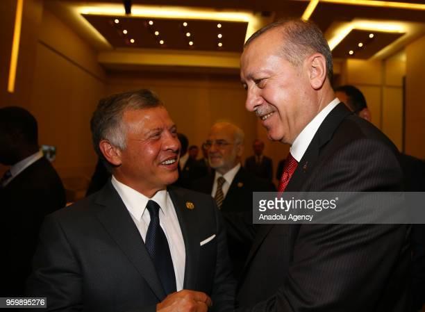 Turkish President Recep Tayyip Erdogan chats with Jordanian King Abdullah II during the Organization of Islamic Cooperation Extraordinary Islamic...