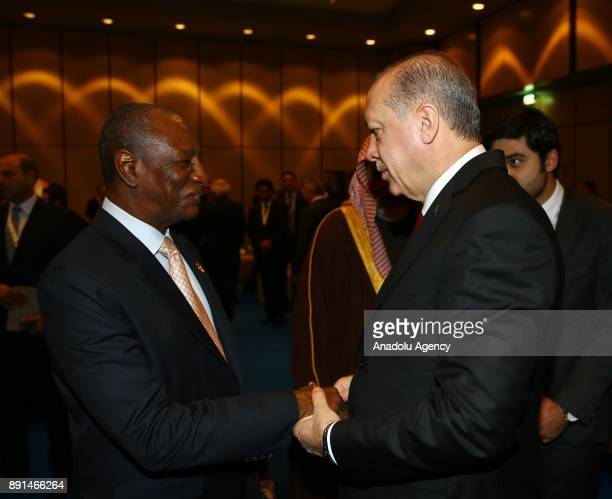 Turkish President Recep Tayyip Erdogan chats with President of Guinea Alpha Conde within the extraordinary summit of the Organization of Islamic...