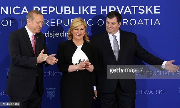 Turkish President Recep Tayyip Erdogan Croatian President Kolinda GrabarKitarovic and her husband Jakov Kitarovic pose during a welcome ceremony at...