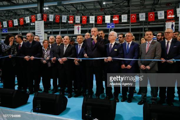 Turkish President Recep Tayyip Erdogan cuts the ribbon during the opening ceremony of the Tirsan Kardan in Manisa Turkey on January 05 2019