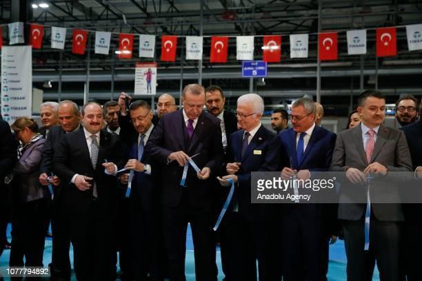Turkish President Recep Tayyip Erdogan cuts the ribbon during the opening ceremony of the Tirsan Kardan in Manisa Turkey on January 05 2019