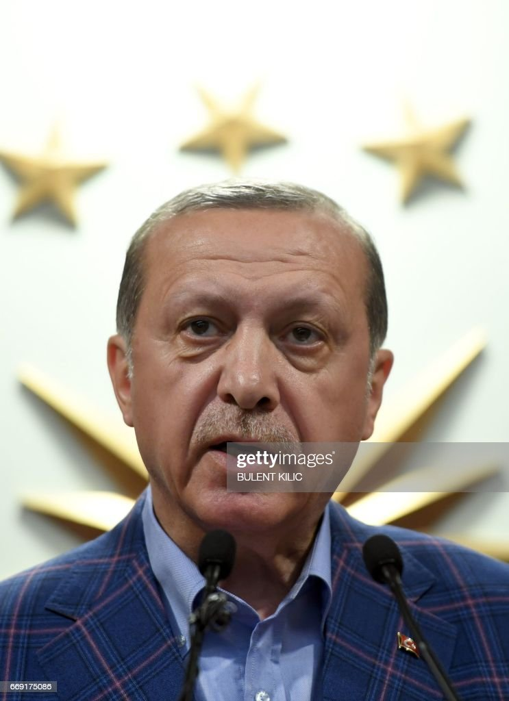 Turkish president Recep Tayyip Erdogan delivers a speech at the conservative Justice and Development Party (AKP) headquarters in Istanbul, on April 16, 2017, after the results of a nationwide referendum that will determine Turkey's future destiny. Erdogan on April 16, 2017 hailed Turkey for making a 'historic decision' as he claimed victory in the referendum on a new constitution expanding his powers. The 'Yes' campaign to give Turkish President expanded powers won with 51.3 percent of the vote a tightly-contested referendum although the 'No' camp had closed the gap, according to initial results. But Turkey's two main opposition parties said they would challenge the results. / AFP PHOTO / Bulent Kilic