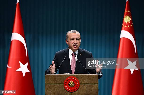 Turkish President Recep Tayyip Erdogan delivers a speech during a press conference after the National Security Council and Cabinet meetings at the...