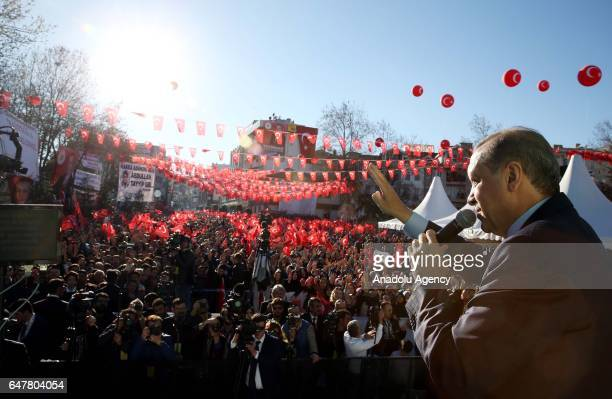 Turkish President Recep Tayyip Erdogan delivers a speech during a mass opening ceremony in front of the Tekirdag governorate building as the crowd...