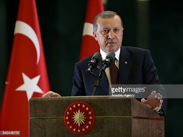 Turkish President Recep Tayyip Erdogan delivers a speech during the fastbreaking dinner with the leaders of the Foreign Economy Relations Board at...