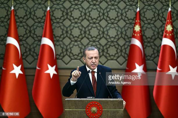 Turkish President Recep Tayyip Erdogan delivers a speech during the 29th Muhktars Meeting at the Presidential Complex in Ankara Turkey on October 26...