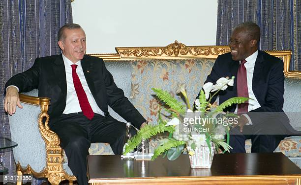 Turkish President Recep Tayyip Erdogan discusses with Ghana's Vice President Kwesi Bekoe AmissahArthur during a diplomatic meeting in Accra on...