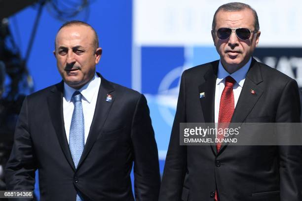 Turkish President Recep Tayyip Erdogan flanked by Turkish Minister for Foreign Affairs Mevlut Cavusoglu arrives for the NATO summit at the NATO...