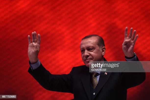 Turkish President Recep Tayyip Erdogan flashes the fourfinger 'rabia sign' on April 12 2017 during a 15 July Martyrs meeting and a campaign rally for...