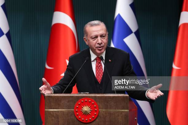 Turkish President Recep Tayyip Erdogan gestures as he delivers a speech during a joint press conference with Greek Prime Minister following a meeting...