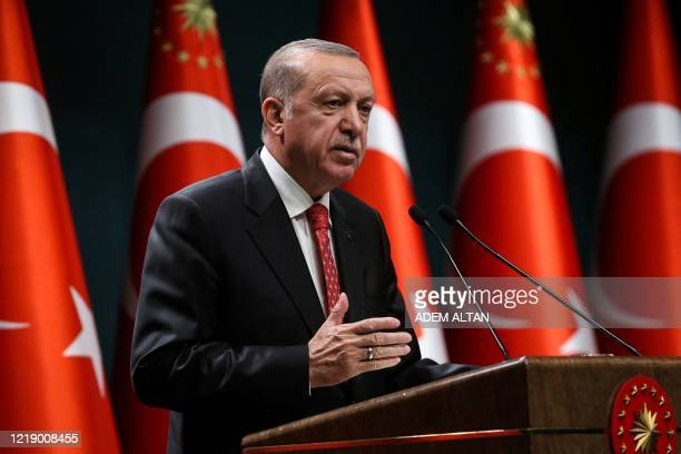 Turkish President Recep Tayyip Erdogan gestures as he delivers a speech following a cabinet meeting in Ankara on June 9 2020