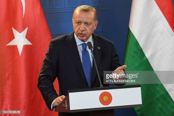 Turkish President Recep Tayyip Erdogan gestures during a joint press conference with the Hungarian Prime Minister following official talks in the...