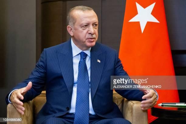 Turkish President Recep Tayyip Erdogan gestures during a meeting with Russian President Vladimir Putin in the Bocharov Ruchei residence in the Black...