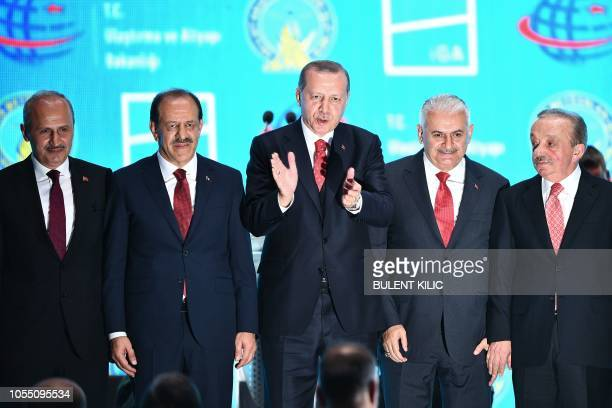 Turkish President Recep Tayyip Erdogan gestures during the opening ceremony of Istanbul's new international airport in the Arnavutkoy district on the...