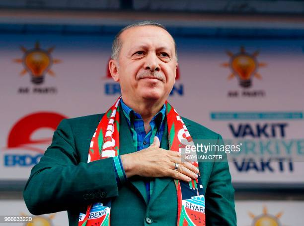 Turkish President Recep Tayyip Erdogan gestures during Turkey's ruling Justice and Development Party's rally in Diyarbakir on June 3 2018 Turkey's...