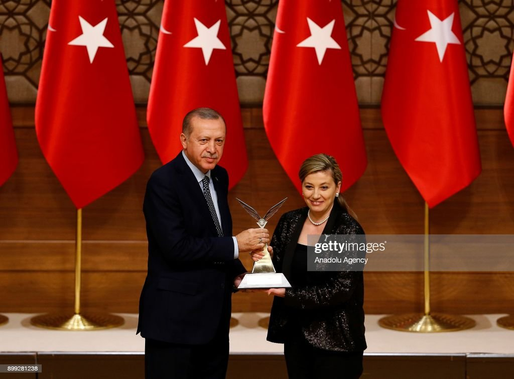 Turkish President Recep Tayyip Erdogan (front L) gives the encouragement award to Prof. Dr. Sule Erten Ela (front R) during the 2017 Scientific and Technological Research Council of Turkey (TUBITAK) award ceremony at the Presidential Complex in Ankara, Turkey on December 28, 2017.