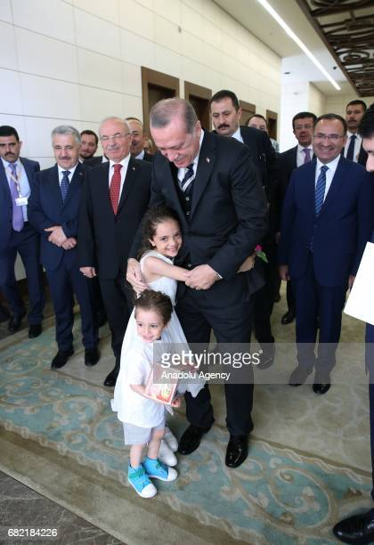 Turkish President Recep Tayyip Erdogan gives Turkish identity cards to sevenyearold Syrian girl Bana AlAbed and her family after they took Turkish...