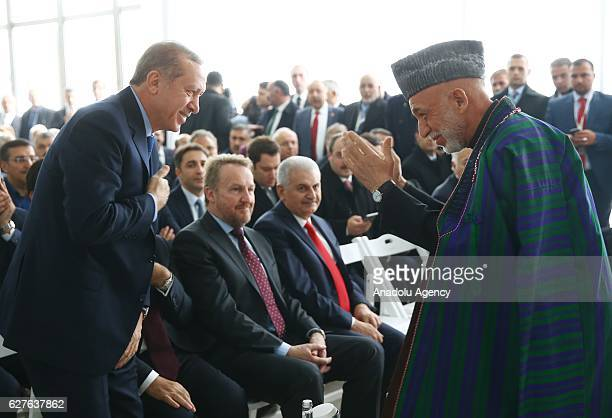 Turkish President Recep Tayyip Erdogan greets Former President of Afghanistan Hamid Karzai during the opening ceremony of Abdullah Gul Museum and...