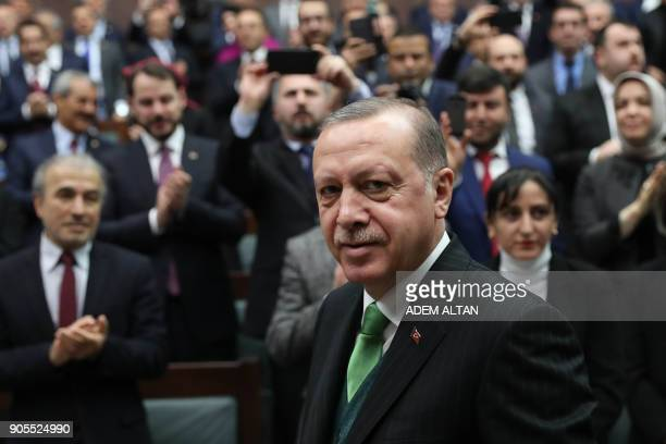 Turkish President Recep Tayyip Erdogan greets people during the Justice and Development Party group meeting at the Grand National Assembly of Turkey...