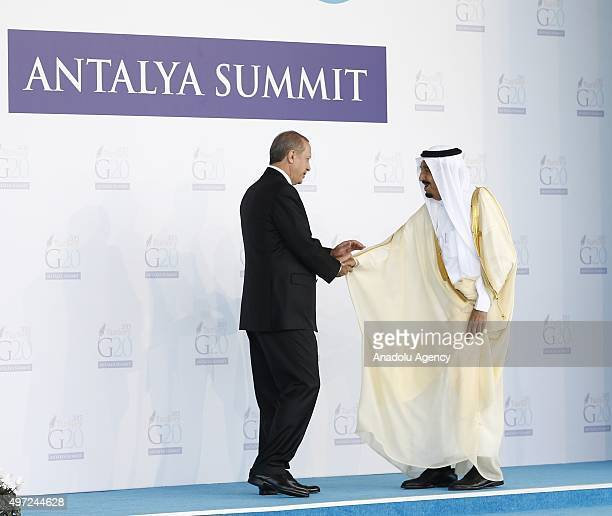 Turkish President Recep Tayyip Erdogan greets Saudi King Salman bin Abdul Aziz Al Saud during the 'Welcoming Ceremony' prior to the G20 Turkey...