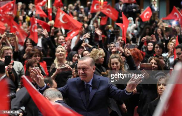 Turkish President Recep Tayyip Erdogan greets supporters as he attends a 'YES' campaign meeting at Bestepe People's Culture and Congress Center in...