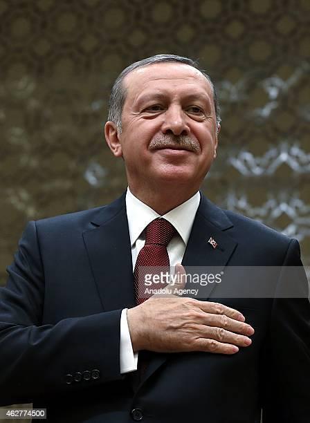 Turkish President Recep Tayyip Erdogan greets the audience as he addresses to members of the Confederation of Turkish Tradesmen and Craftsmen at the...