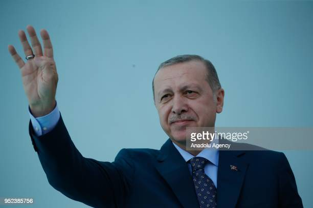 Turkish President Recep Tayyip Erdogan greets the crowd after attending AK Party's 6th ordinary provincial congress in western Izmir province Turkey...