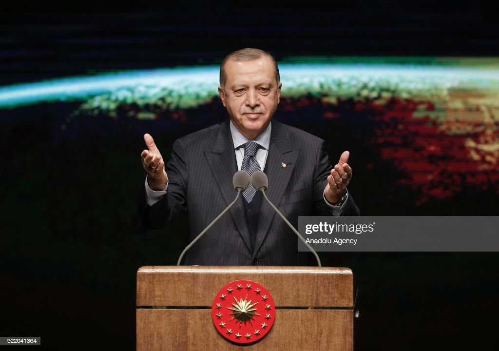 Turkish President Recep Tayyip Erdogan greets the crowd as he attends the 11th Development Plan Publicity Meeting at the Bestepe National Congress and Culture Center in Ankara, Turkey on February 21, 2018.