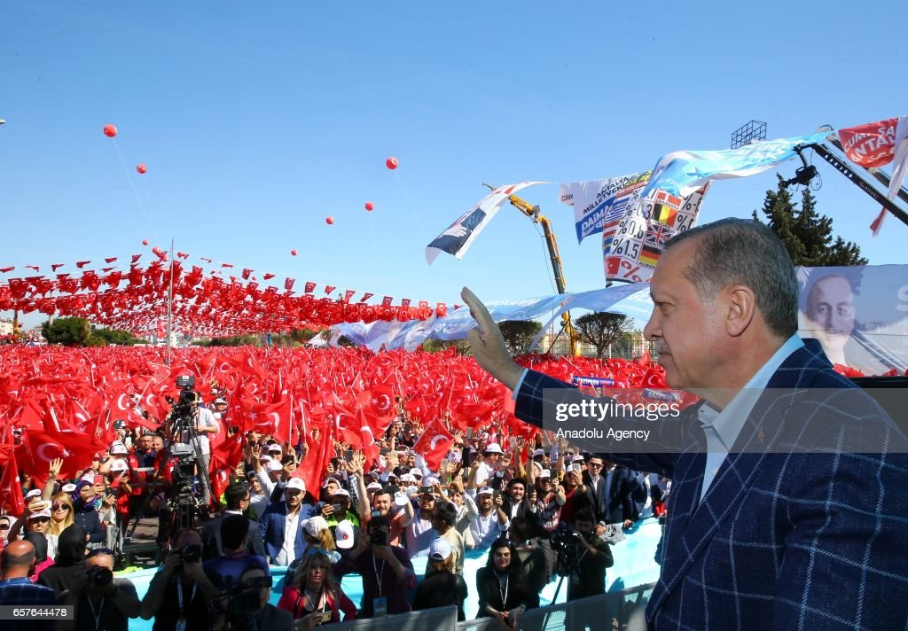 Turkish President Recep Tayyip Erdogan greets the crowd during a mass opening ceremony at Kepez Arena in Antalya, Turkey on March 25, 2017.