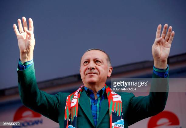 Turkish President Recep Tayyip Erdogan greets the crowd during Turkey's ruling Justice and Development Party's rally in Diyarbakir on June 3 2018...