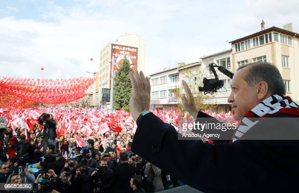 Turkish President Recep Tayyip Erdogan greets the crowd during the meeting titled 'Corum gathering' at Abide Square in Corum Turkey on April 10 2017