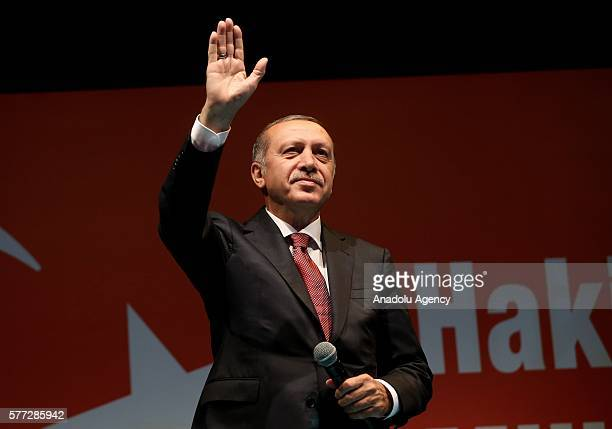 Turkish President Recep Tayyip Erdogan greets the crowd who gathered in front of his residence in Kisikli to protest against Parallel State/Gulenist...