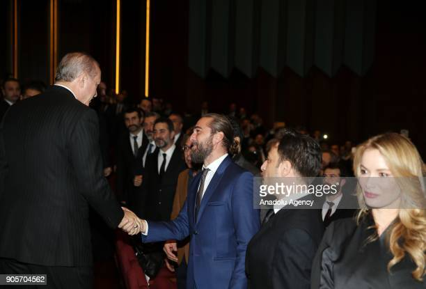 Turkish President Recep Tayyip Erdogan greets the Turkish actor Engin Altan Duzyatan during the premiere of the 'Kut'ul Amare' TV serie at Bestepe...